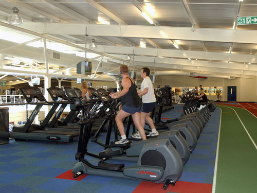 Total Fitness says it's turning things around