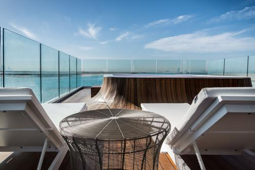 The outdoor deck features a glass-bottomed Jacuzzi / Kleindienst Group