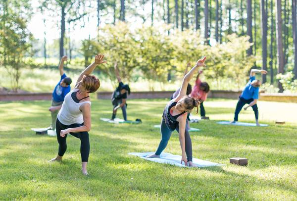 Serenbe offers a varied fitness programme that includes group yoga. A growing body of research suggests that exercising outdoors is better for you than working out indoors