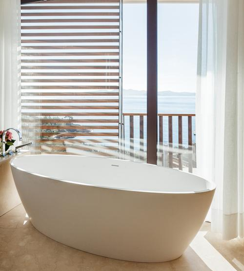 Each of the resort's 141 bedrooms offers views of the Aegean Sea