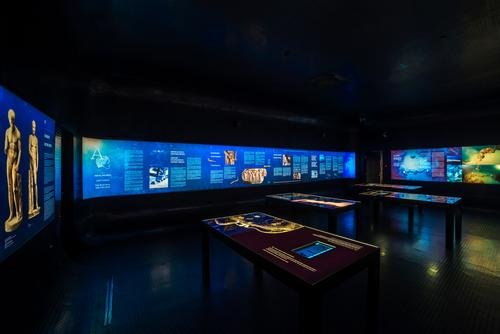 Within the dark area, visitors can learn the history, context, discovery, and restoration of Apoxyomenos via illuminated displays detailing the statue's past / Museum of Apoxyomenos