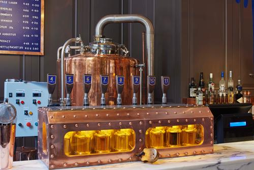 The copper vessels of the brewery are an eye-catching addition to the former bank building / James Harris