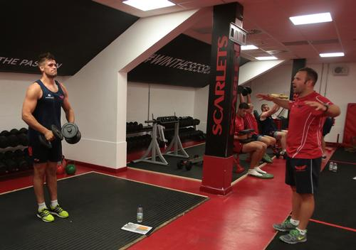 Scarlets' Phil Day trains alongside forwards conditioner Ian Gibbons, with players Lewis Rawlins, Craig Price and Jake Ball in the background