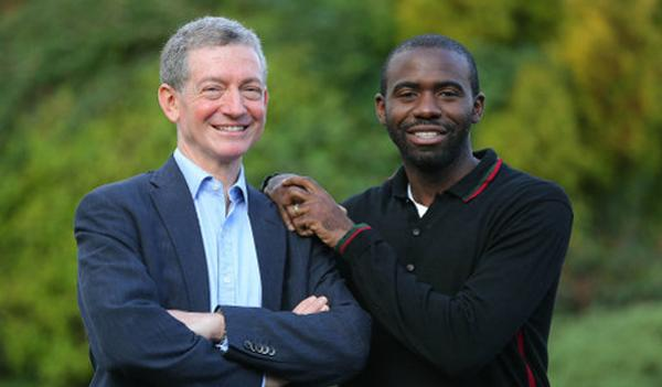 Retired footballer Fabrice Muamba (right), who suffered a cardiac arrest on the pitch during an  FA Cup match in 2012 with Andrew Deaner (left), one of the men who saved his life / olesia bilkei / shutterstock