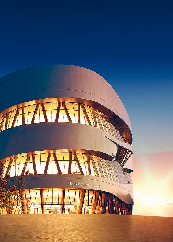 The curved Mercedes-Benz Museum in Stuttgart is located on an artificial hill