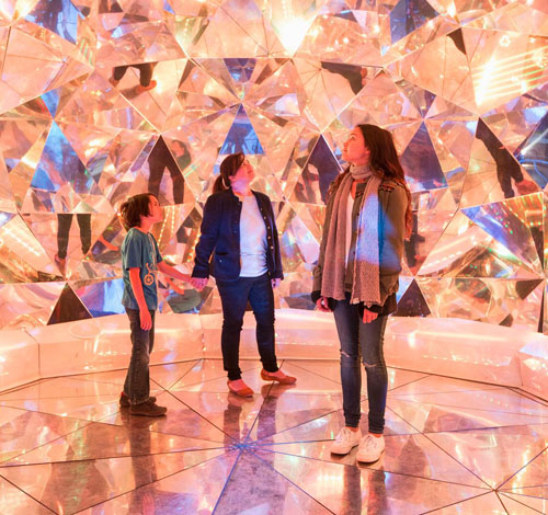 Made up of more than 320 geometric shapes, the 'Light Origami' installation constantly shifts and alters viewers' spectrum of light / Vivid Sydney