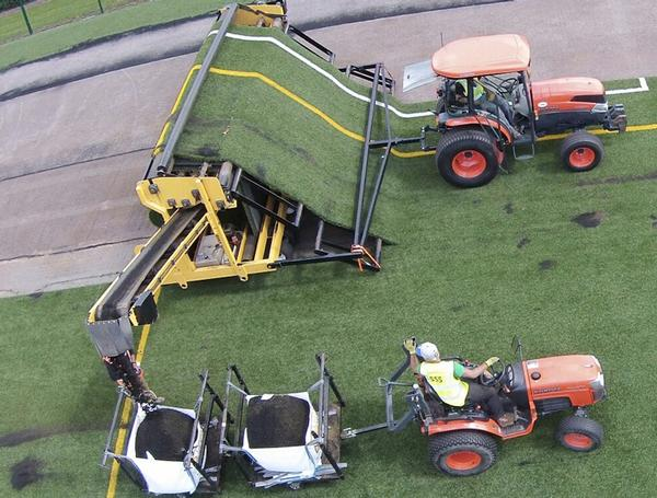 The Chelsea FC pitch being removed using SMS' Turf Muncher machine