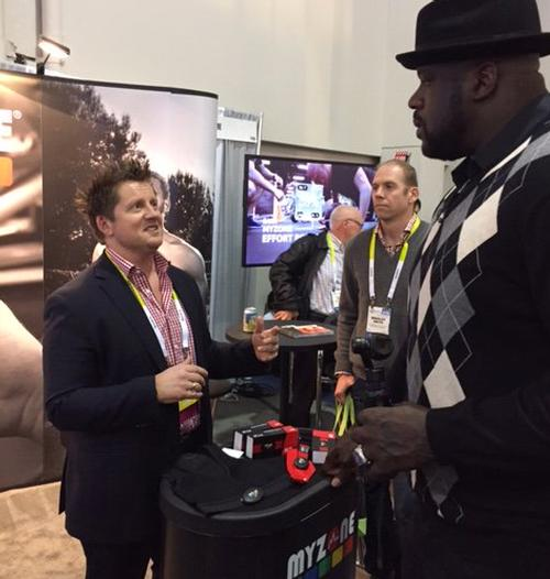 Dave Wright welcomes basketball legend Shaquille O'Neal to the MyZone stand at CES 2016 / Twitter / MYZONEmoves