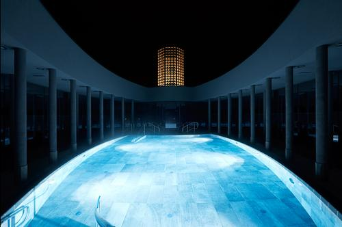 The spa is constructed in a pattern of four ellipses that revolve around the central fountain