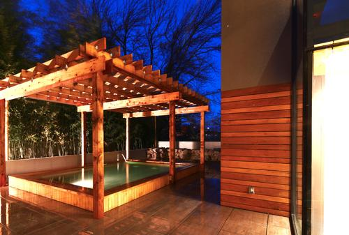 SoJo Spa Club features a number of specialty outdoor soaking experiences including hinoki wood (pictured), carbon-rich and silk baths