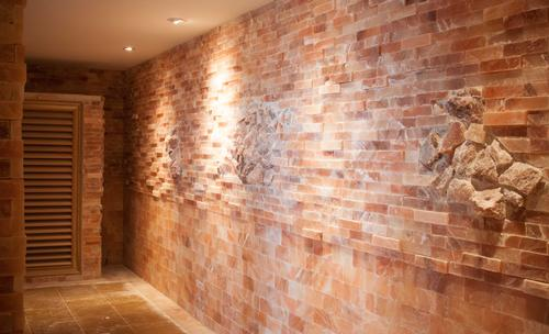 The pink salt bricks in the salt sauna at SoJo Spa Club traveled more than 7,400 miles from the Himalayas
