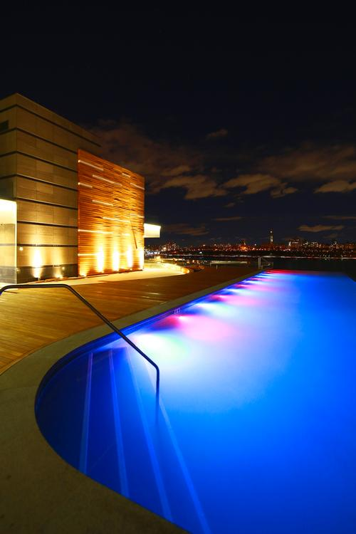 The rooftop infinity pool features sweeping views of the New York skyline