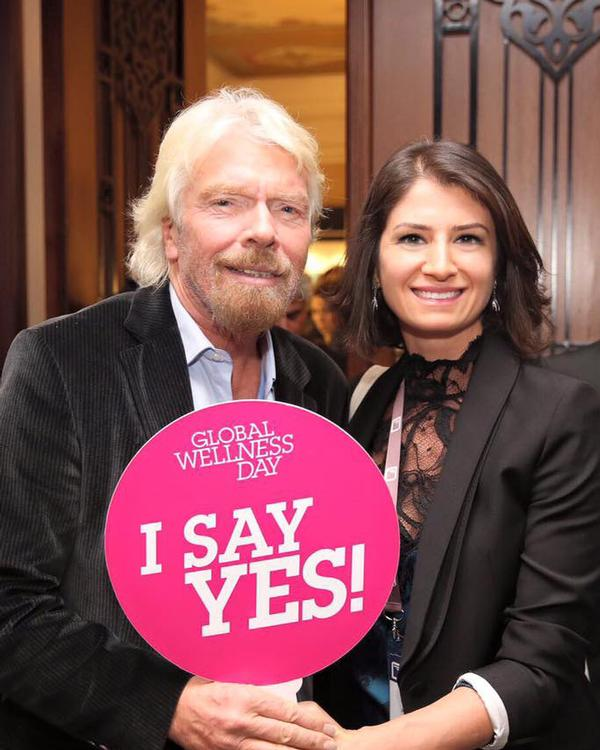 Global Wellness Day founder, Belgin Aksoy, with Virgin boss Sir Richard Branson