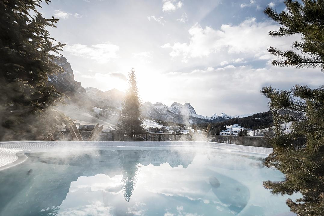 An outdoor pool surrounded by the Dolomites is one feature of the Tofana / noa*