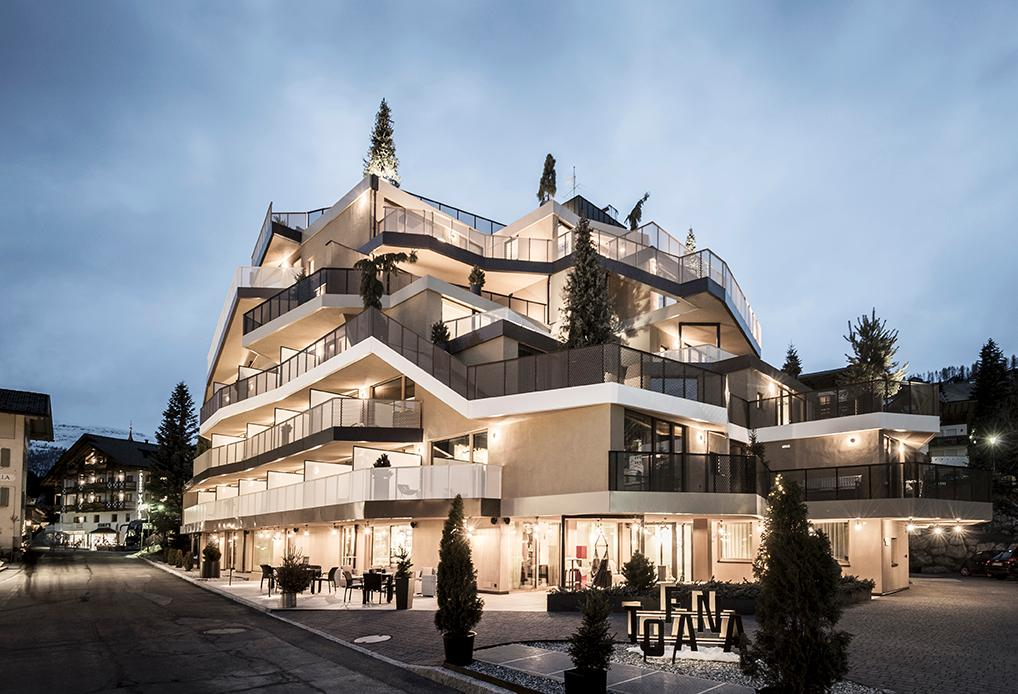 The irregular, asymmetrical silhouette of the Hotel Tofana is designed to evoke a tree-lined mountain peak / noa*
