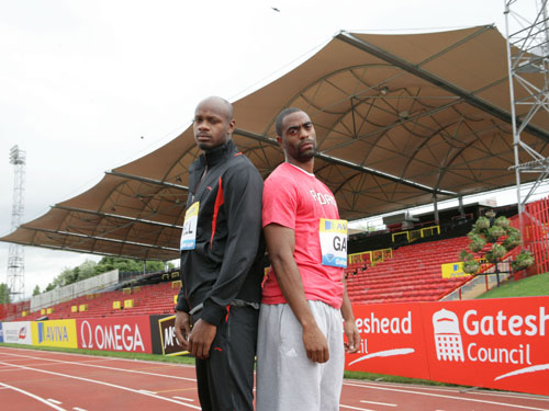 Sprinters Asafa Powell and Tyson Gay in front of the new-look East Stand