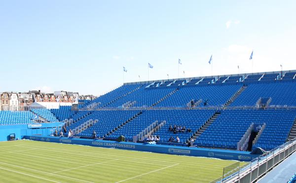 The livery at The Queen's Club in  Wimbledon was changed from red  to blue when AEGON took over from  Stella Artois as the event sponsors