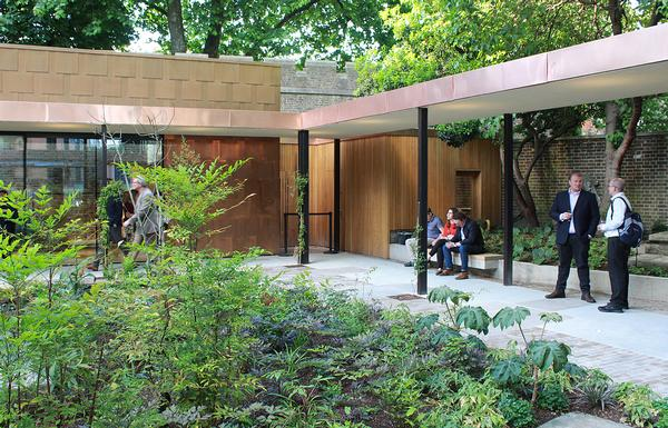 The new extension includes a garden classroom and surrounds a courtyard planted by Dan Pearson