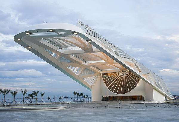 The museum's skeletal roof soars above a public plaza