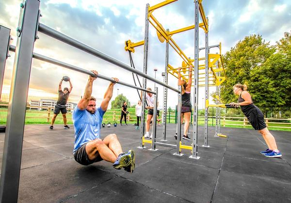 Physical Company offers a series of 30-minute small group training workouts to be done on its rigs