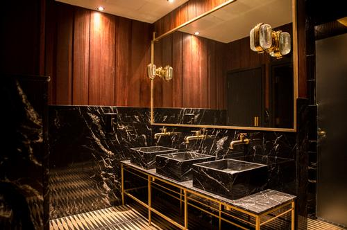 The centre's changing rooms feature marble finishes, brass lockers with USB and plug charging connections and rain showers / Jason Ennis – Press Up Entertainment Group