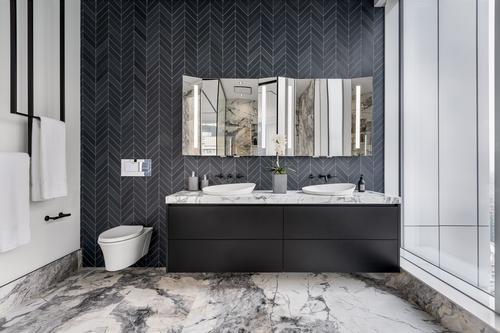 The ensuite bathroom with heated floors, a smart mirror and an AV-connected vibracoustic bath