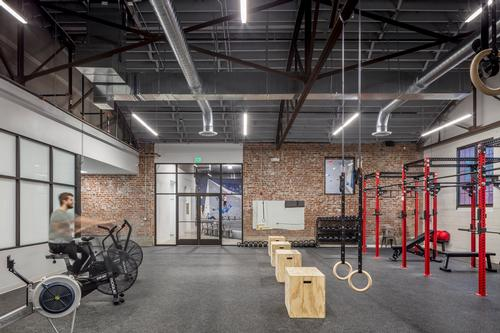 There is a fitness space with weights and cardio equipment and a studio for hosting yoga classes / Bob Greenspan Photography
