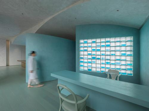 The Chinese medicine counter has a striking aqua design and lighting scheme / Waterfrom Design