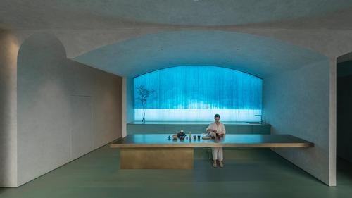 A deep blue lighting feature provides a backdrop for the clinic / Waterfrom Design