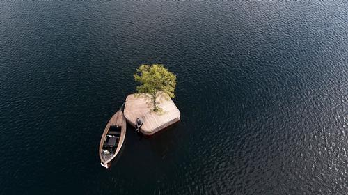 The first of the islands to be released is CPH-Ø1, a small 20sq m, hand-made wooden platform with a linden tree at its centre / www.marshallblecher.com