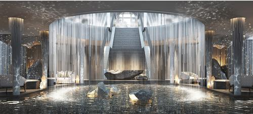 The centrepiece for the resort's open-air lobby comprises a large circular cascading waterfall that falls into a running stream below / Banyan Tree
