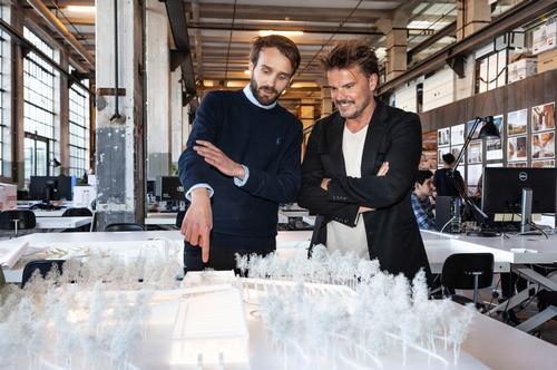 Jan Christian Vestre, CEO of Vestre (left) and Bjarke Ingels viewing a model of The Plus / Vestre/Bjarke Ingles Group