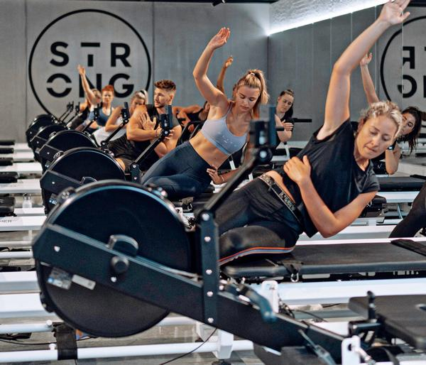 STRONG classes take place on a 'rowformer' machine – part reformer bed, part rowing machine