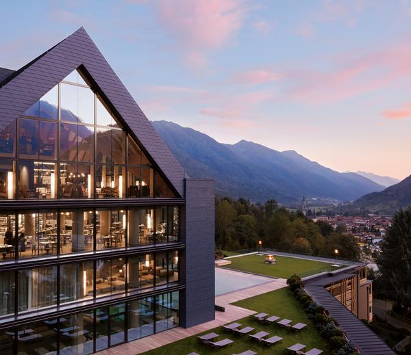 The architecture features clean lines and a diamond shape designed to represent the Dolomite mountains