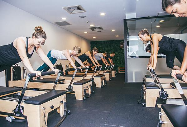 Flow Athletic holds 140 classes per week, including reformer pilates, yoga, spin and strength