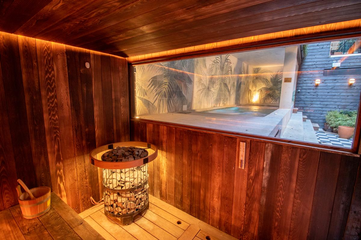 A sauna looks out over the relaxation pool / Jason Ennis – Press Up Entertainment Group