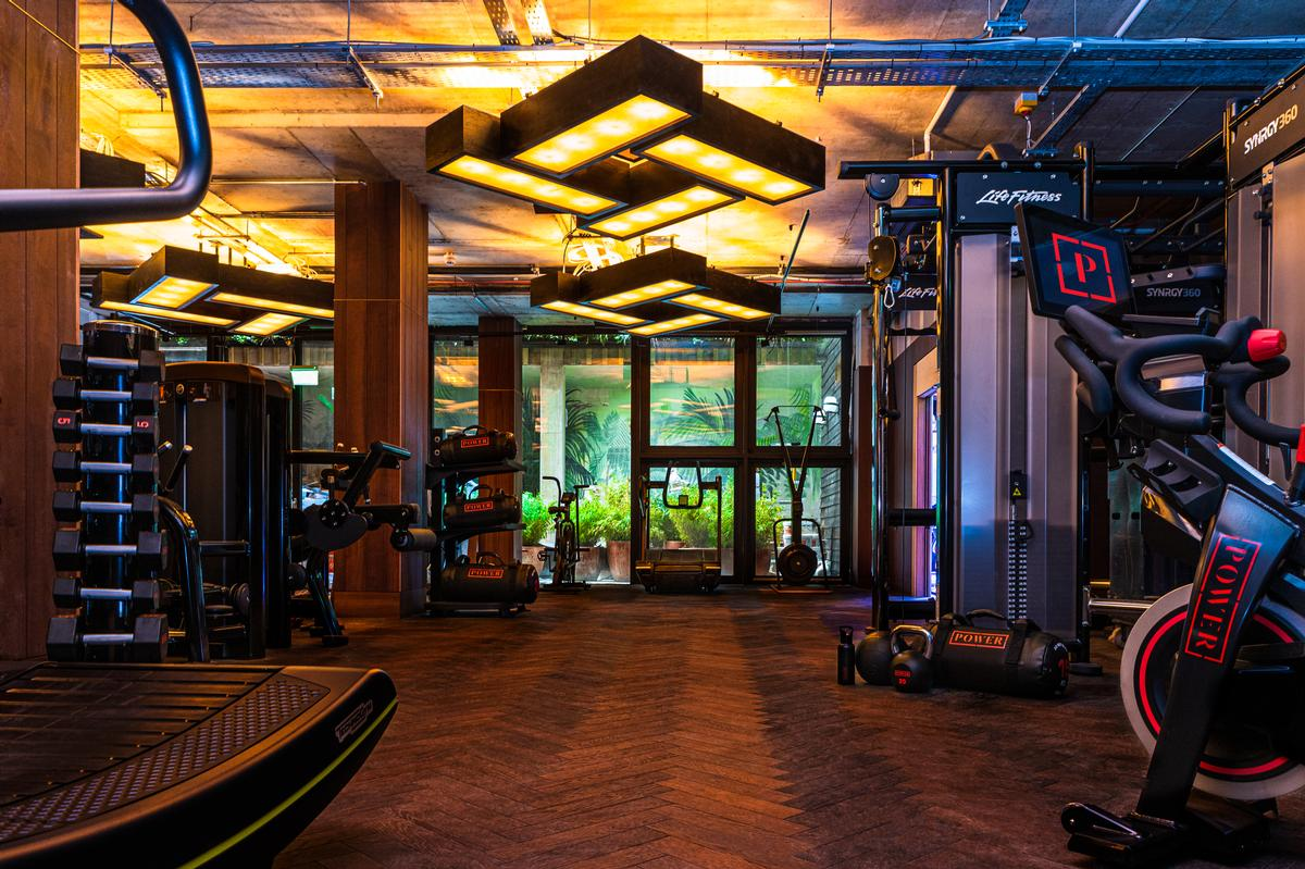 The open gym area features wooden flooring and feature lighting / Jason Ennis – Press Up Entertainment Group