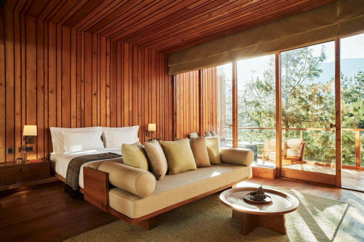The interiors feature a palette of earth tones and handwoven fabrics