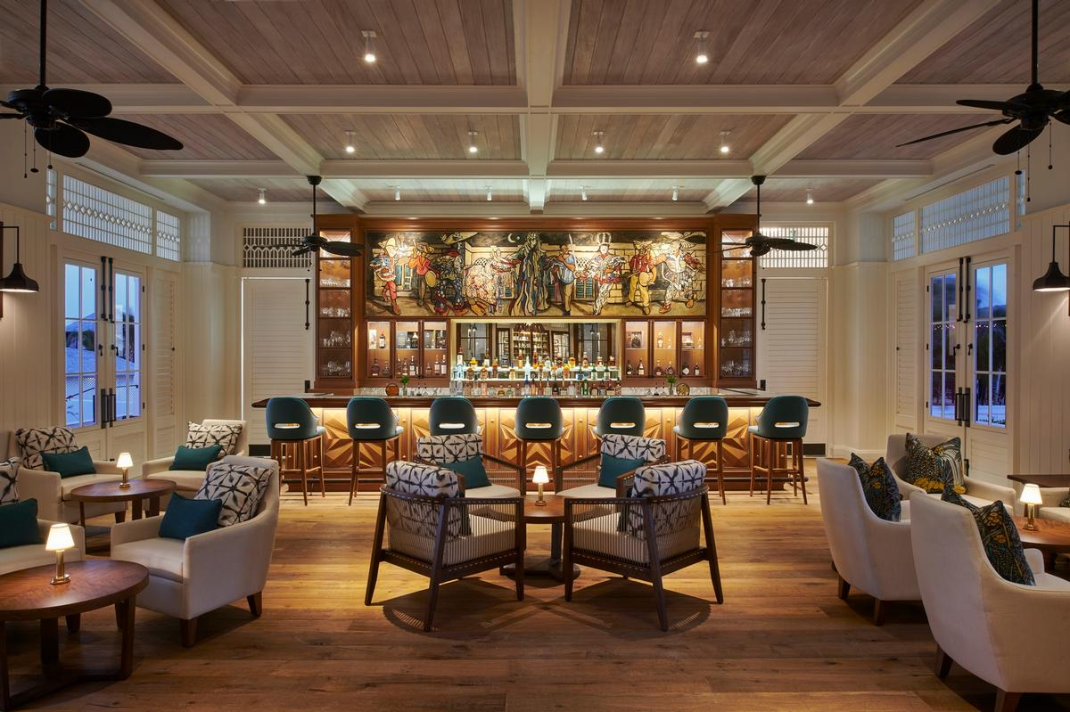 Lester's Bar is inspired by a painting of artist Michael Lester's called 'Junkanoo'