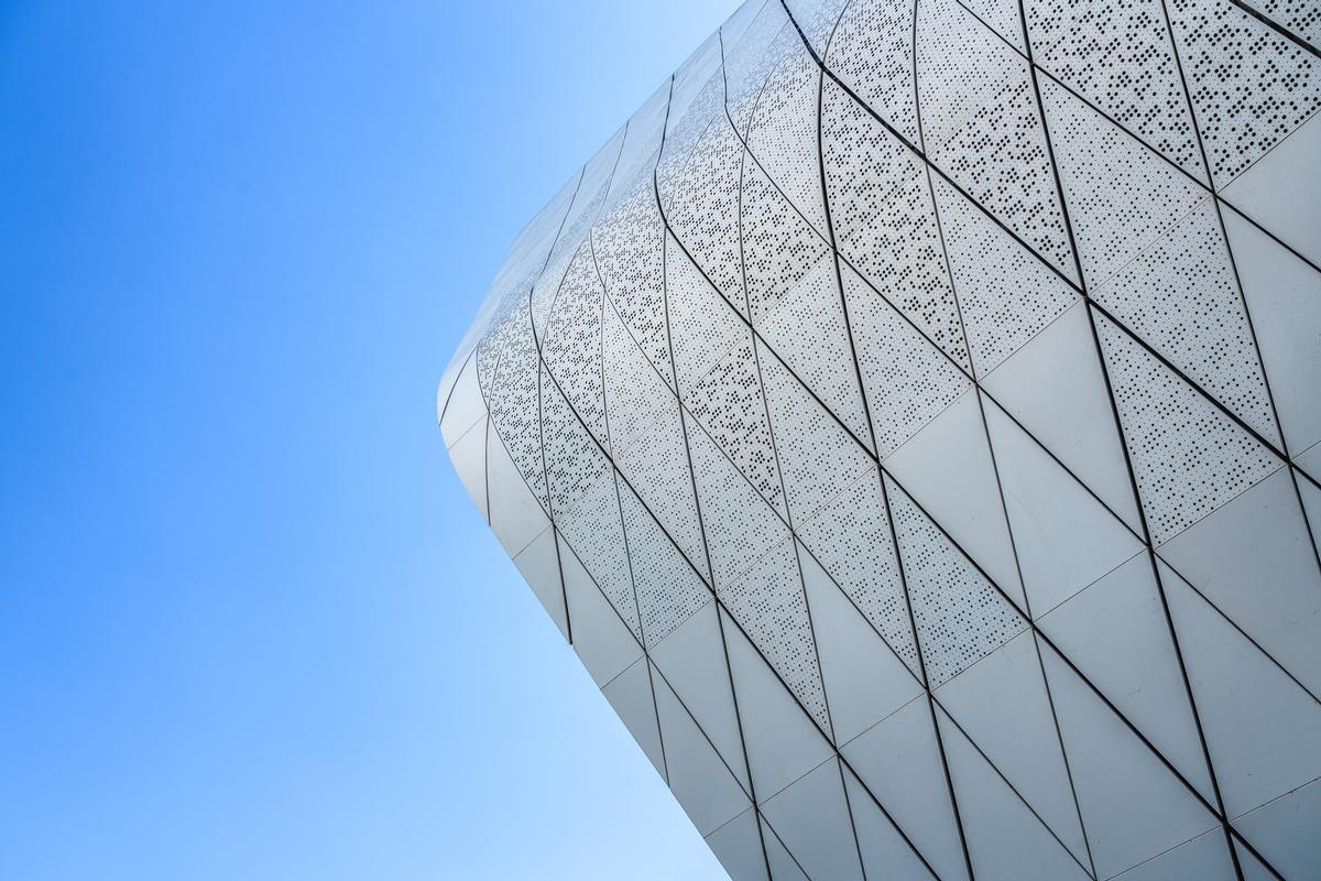 The building is wrapped in an aluminium and glazed façade / Terrence Zhang
