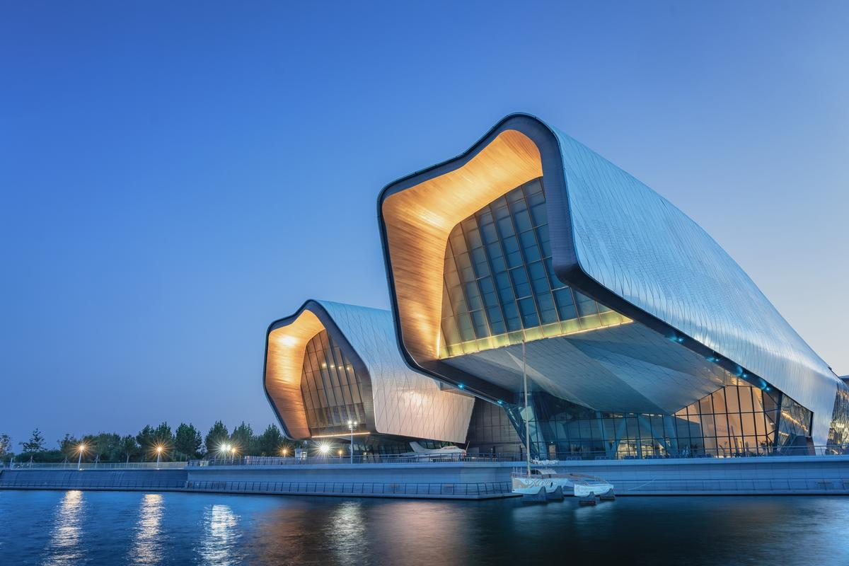 The design was inspired by ideas of jumping carp, corals, starfish, moored ships and an open palm / Terrence Zhang