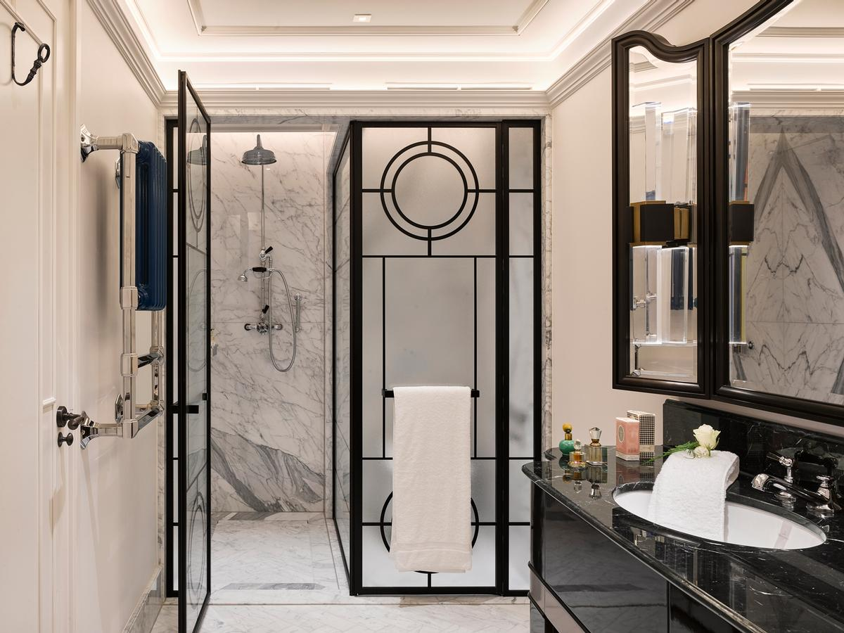 Luxurious bathrooms in the hotel's suites feature book-matched stone / Will Pryce