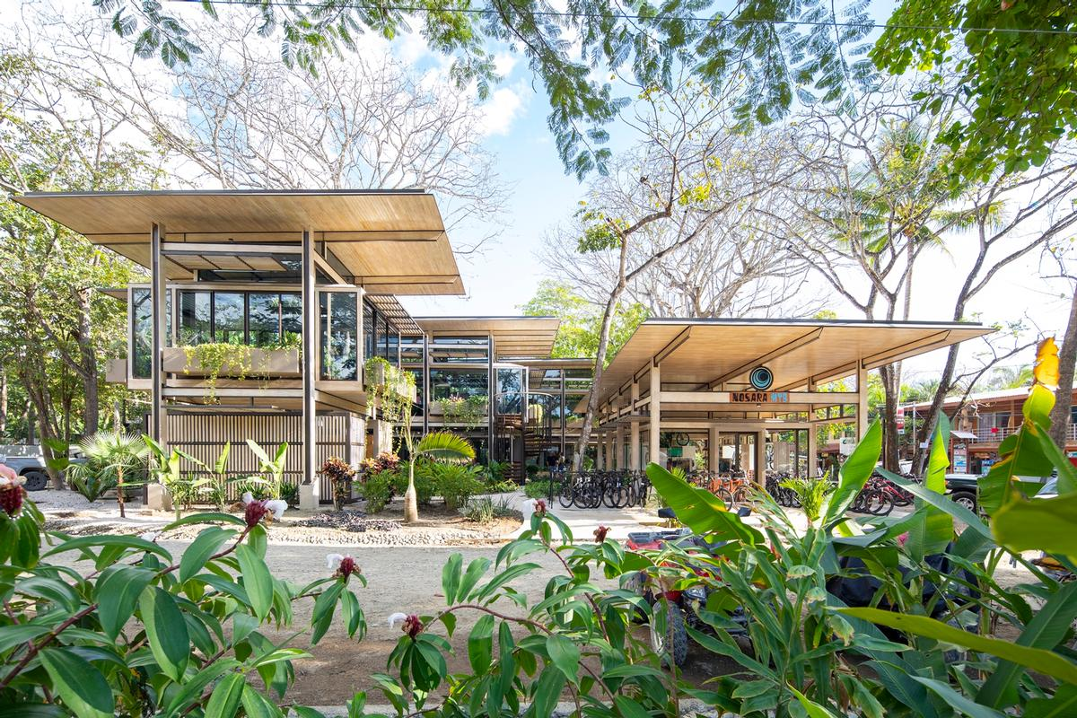 Roof overhangs provide shade for its interiors and collect water for reuse