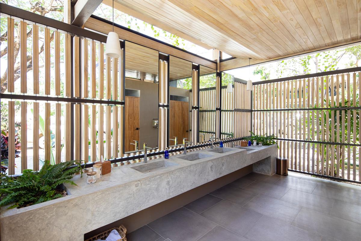 Changing areas use pale materials and are filled with natural light