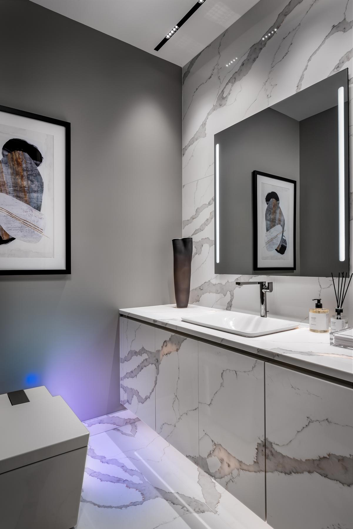 In the bathroom, there's a smart toilet with built-in speakers for playing music