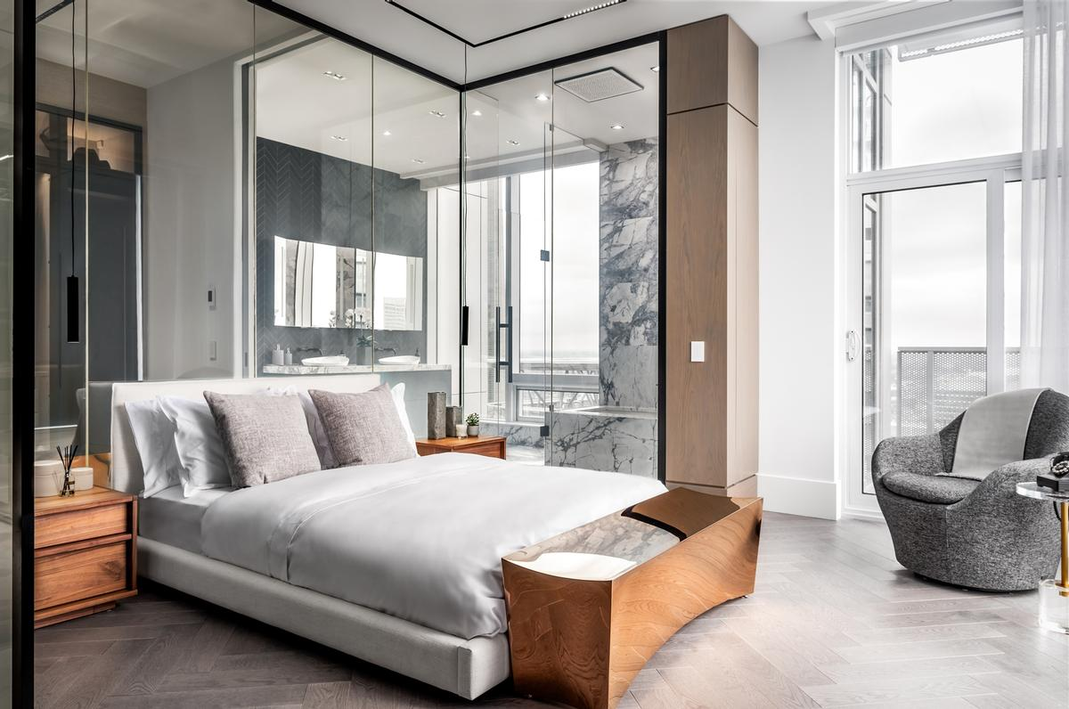 The bedroom features a glass partition that can be switched from transparent to opaque