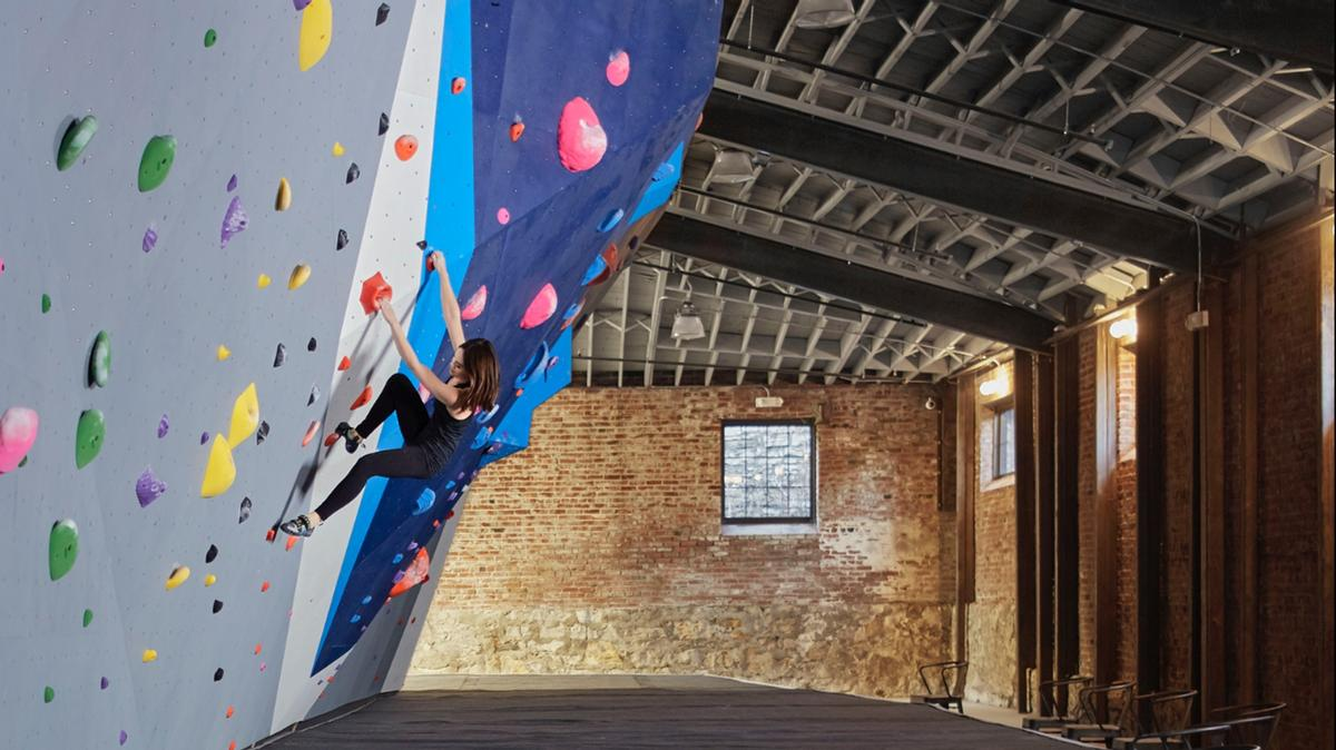 Brickwork in the warehouse was left exposed to contrast with the climbing walls / Andrew Conroy