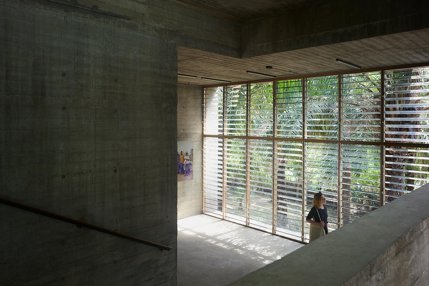 A large floor-to-ceiling window at one end allows natural light into the space / Julien Lanoo