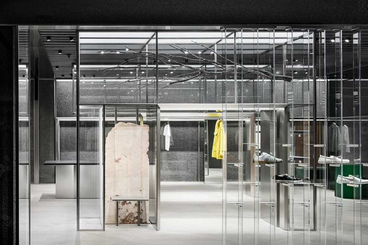 Glass partitions allow views and light through the store