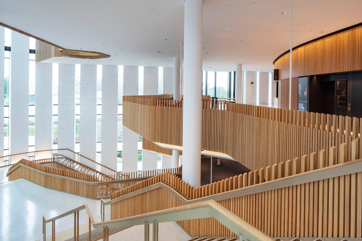Timber, terrazzo and plaster are the main material elements / John Gollings